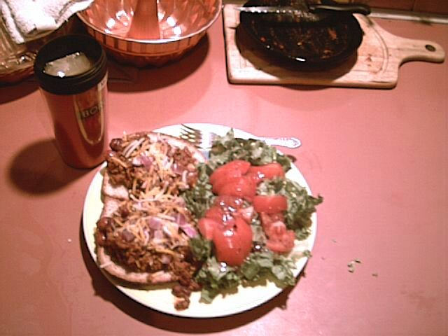 For dinner tonight, I had chili over hot dogs on wheat bread, and a small salad (lettuce, tomatos, vinaigrette).