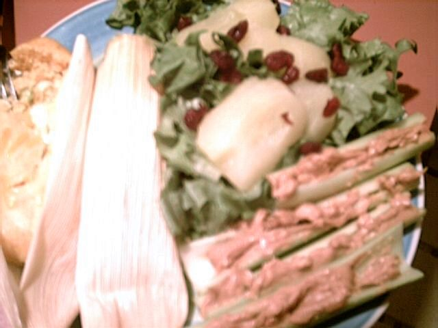 For dinner tonight: Trader Joe's green enchiladas (chiles in white cheese), romaine lettuce with canned apples and dried cranberries, and celery sticks with peanut butter.  Ice water to drink.