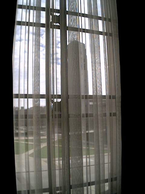The Bell Tower can be seen through the curtains of the upstairs windows in Rackham.